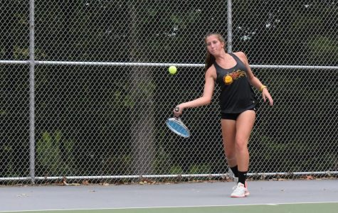 Winnie Grot goes for a forehand in her win vs. Ally Gaines (C) 6-0, 6-0.