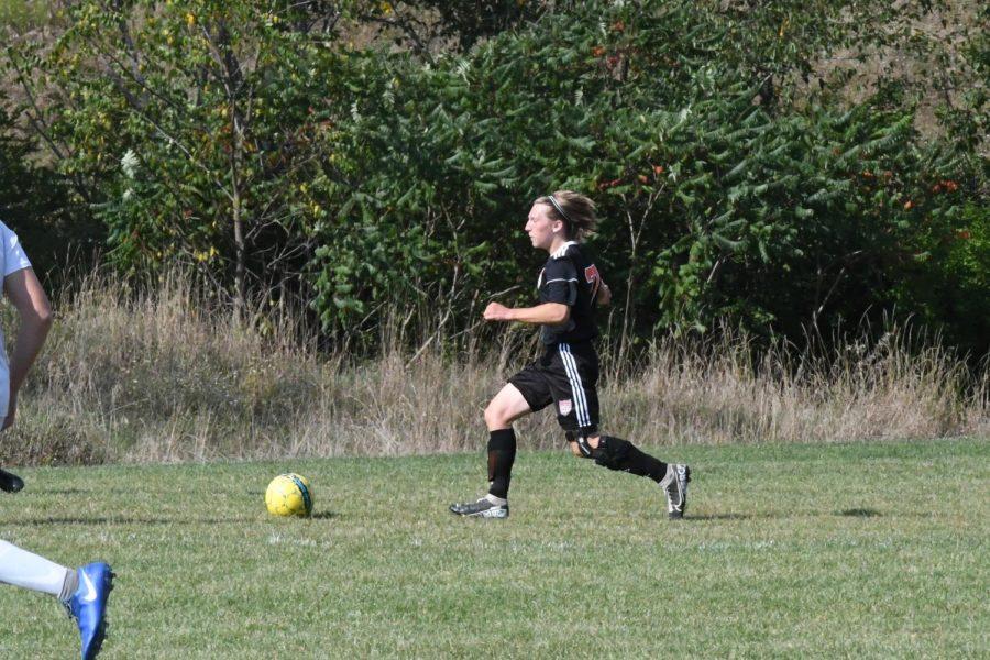 Keegan Raabe dribbling up field