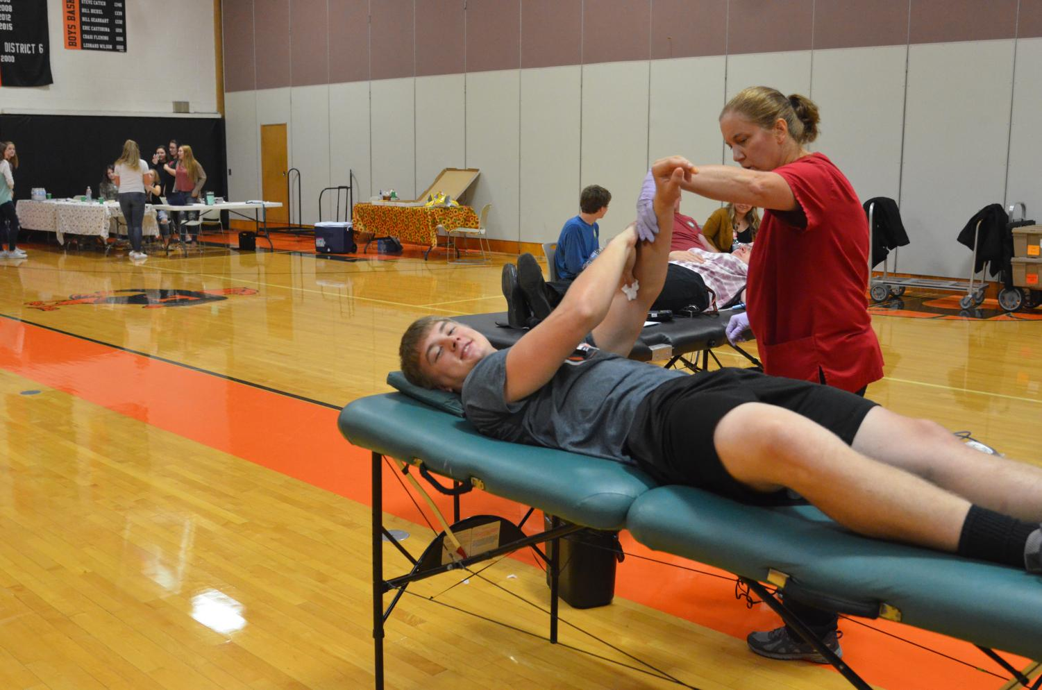 Aric Reader donating blood at last year's blood drive.