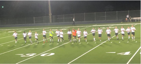 Golden Eagles soccer team doing their cool down after the game.
