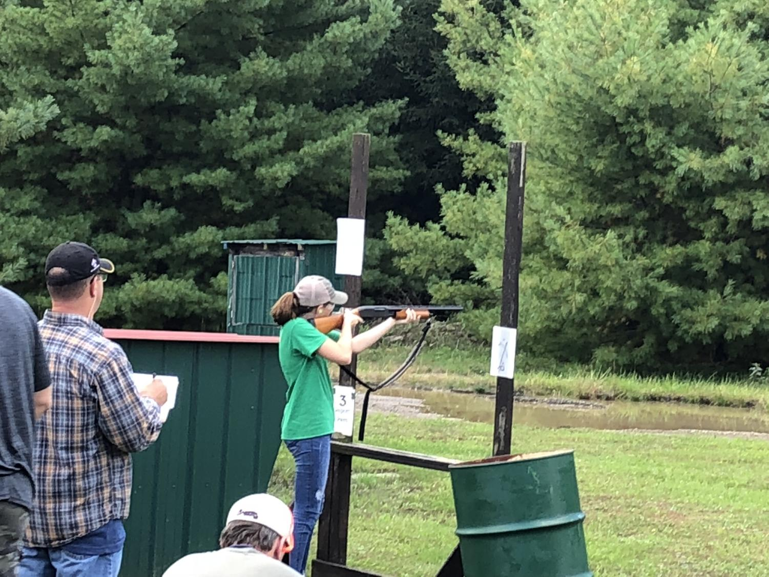 Junior Lyndsey Fleck shooting at the annual Clay Shoot two years ago.
