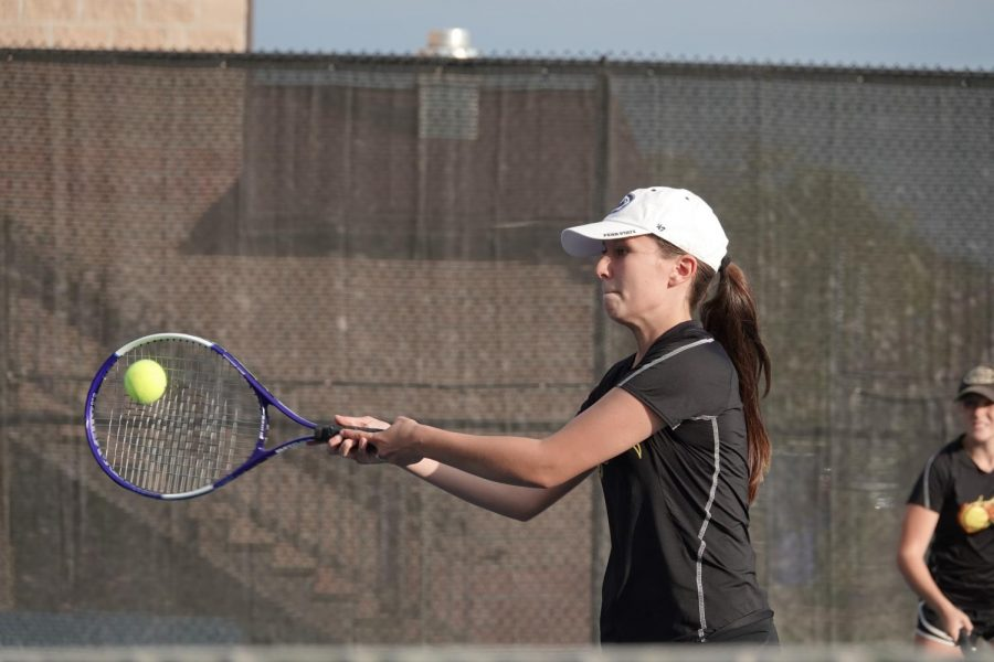 Emilee+Walk+hits+an+awesome+shot+at+the+net.+