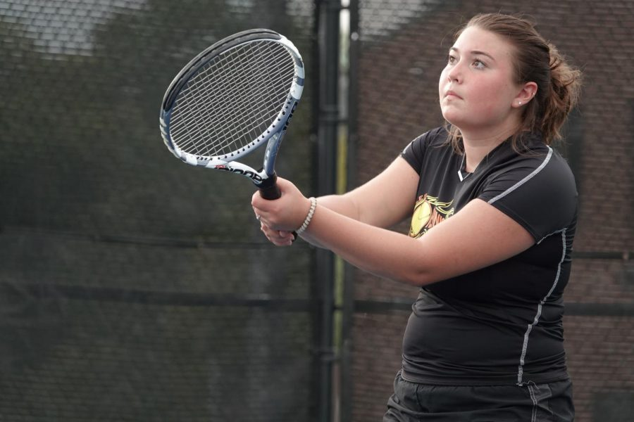 Olivia Reese hits a great backhand at the net.