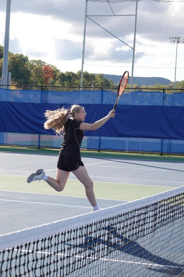 Megan Dale hits an awesome shot at the net.