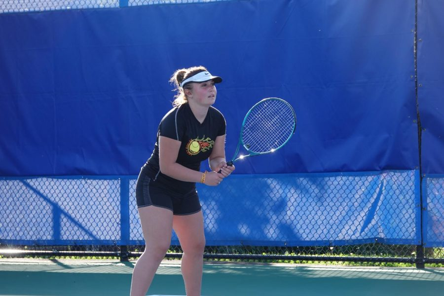 Olivia Reese gets ready to return a serve.