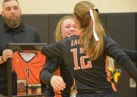 Junior Makenna Bauer and Bri Foy hugging during the senior night ceremony.