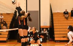 Reagan Irons and Piper Christine going up to block.
