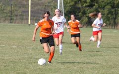 Freshman, Avalyn Moore dribbling the ball down the field, towards the goal.