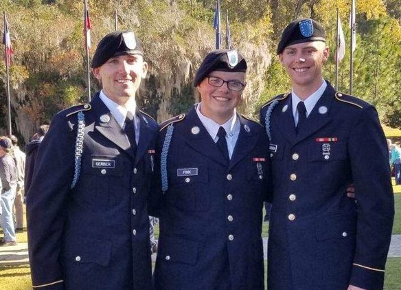 Christian Fink (middle) with two friends he met while in the Army National Guard.
