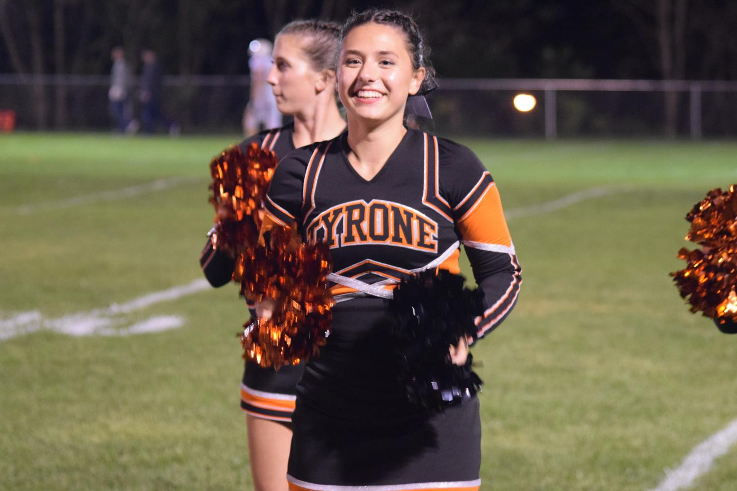 Grace Legars cheering on the sideline.