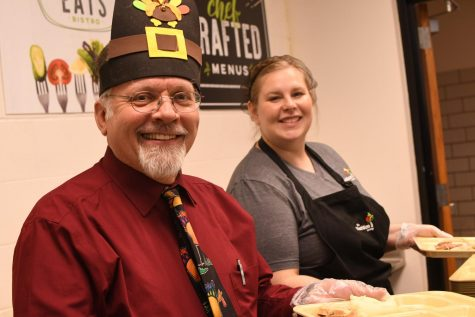 Social studies teacher Cummins McNitt and Food Service Director Amanda Grove serving the good stuff at the annual Thanksgiving dinner at the TAHS cafeteria during last year