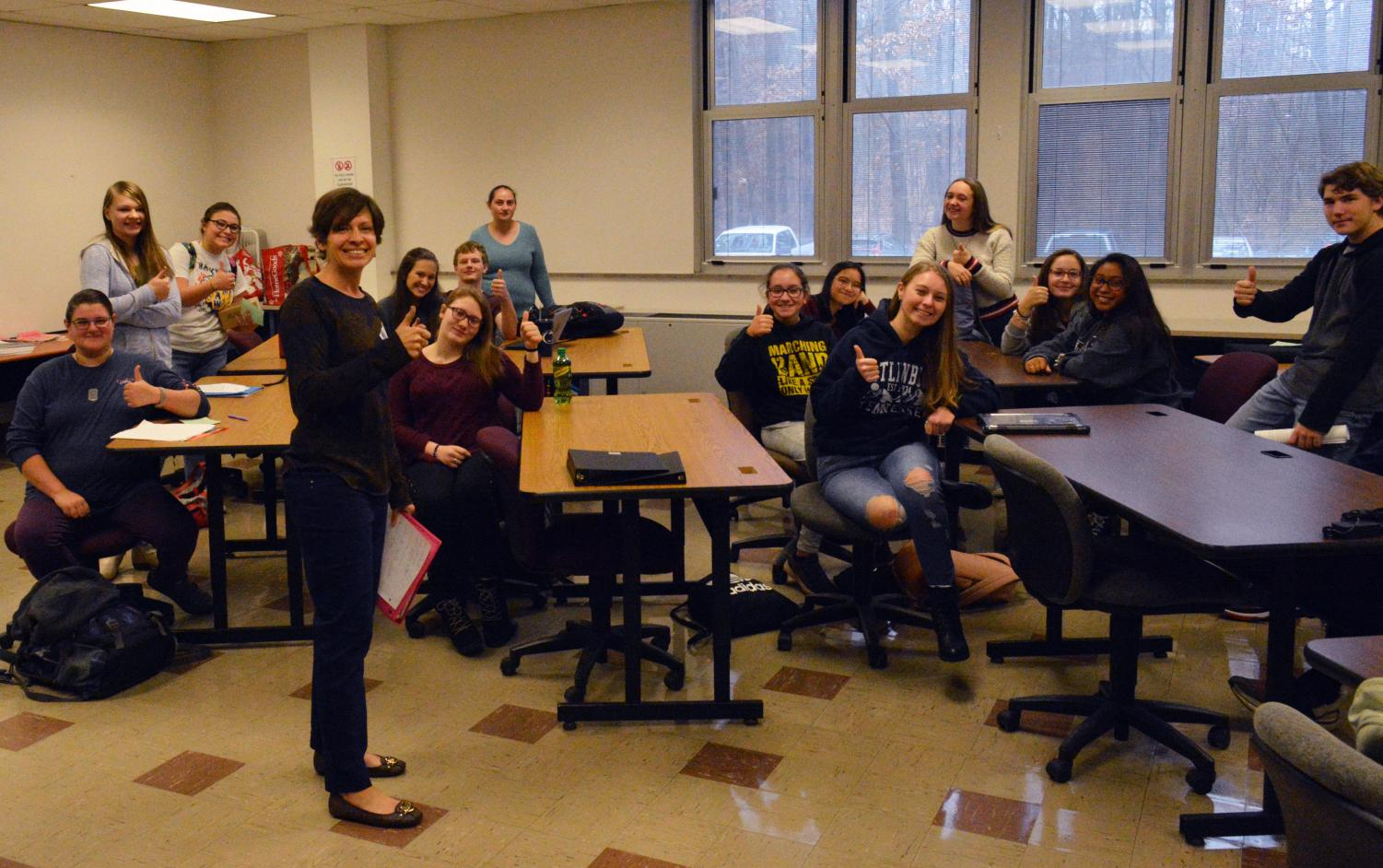 Mrs. Leah Deskevich (standing, front) returns to TAHS to help lead the Speech Team, along with her Co-Adviser Gabby McLarren (far back center).