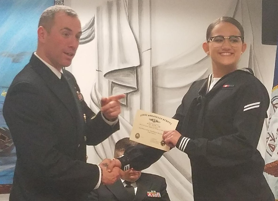 Davina Lee accepts certificate for the United States Navy.