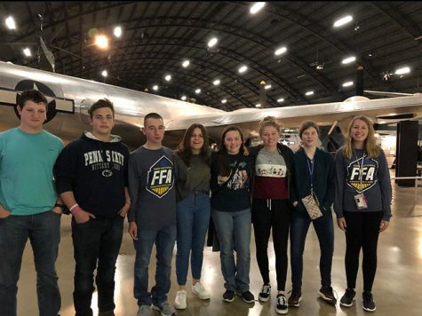 Tyrone Area FFA members pose in the beginning hanger of exhibits at the Air Force Museum.