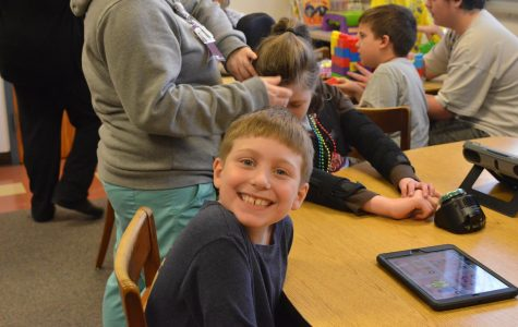 High School and Elementary Students Form Strong Bond through Reading