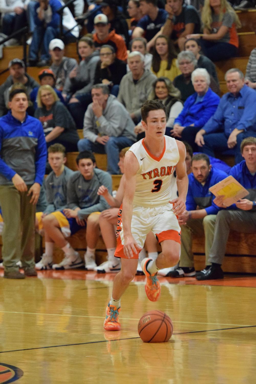 Damon Gripp dribbling up the court.
