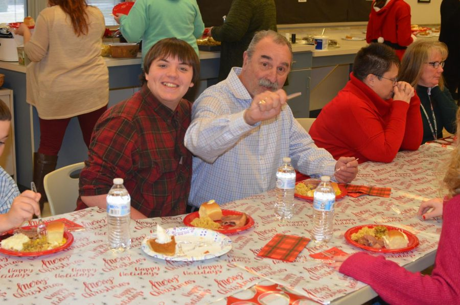 Chad Steele and Mr. Barry Herr enjoying the holiday meal together.