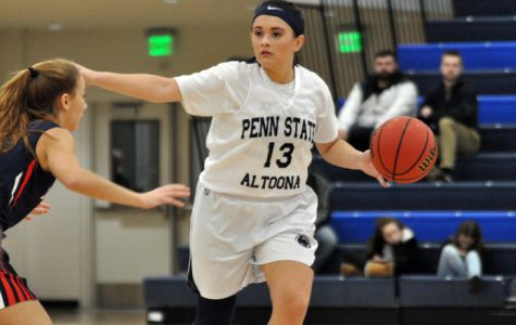 Penn State senior Finnley Christine calls out a play as she brings the ball down the court for the Penn State Altoona Lady Lions.