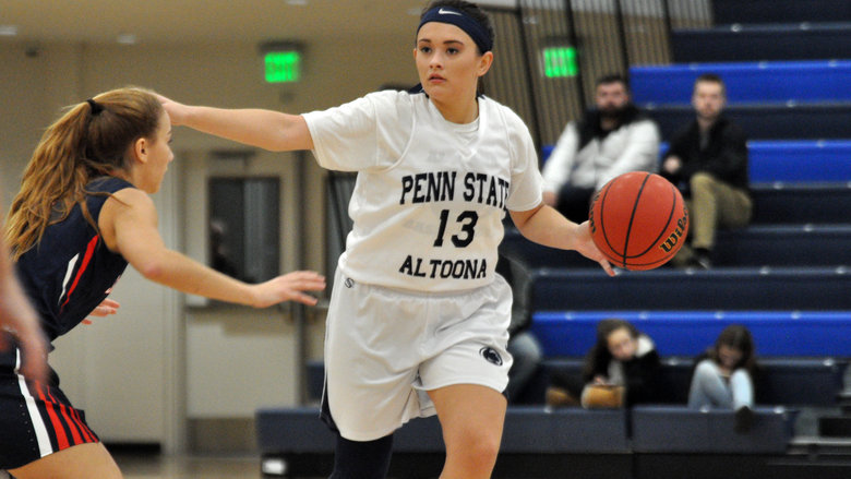Penn+State+senior+Finnley+Christine+calls+out+a+play+as+she+brings+the+ball+down+the+court+for+the+Penn+State+Altoona+Lady+Lions.
