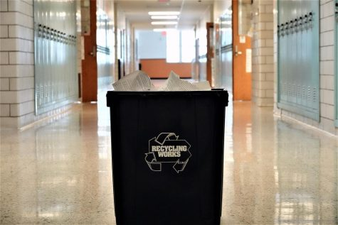 One of the few recycling bins at Tyrone High School is located in the copy room next to Mr. Wilson