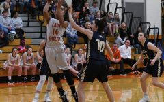 Lady Eagles Claw the Bearcats; Move to 12-2
