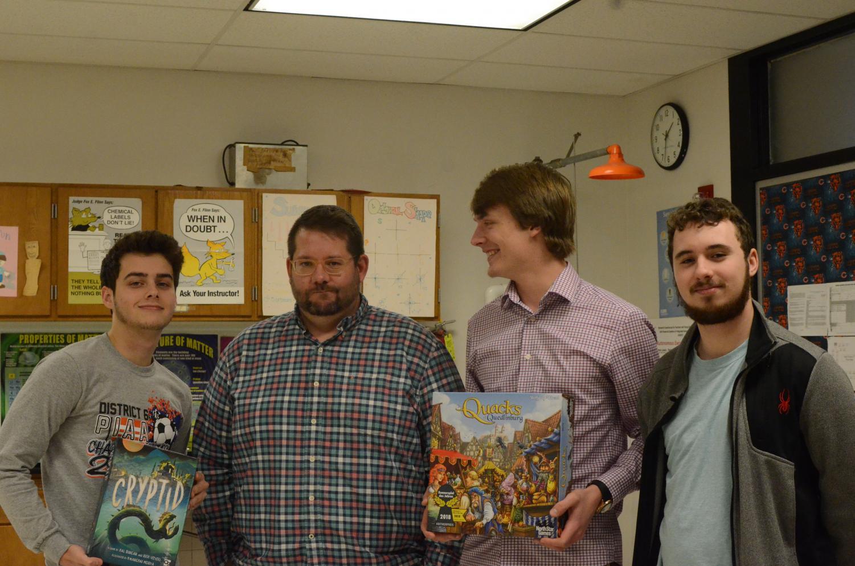 Mr. Funicelli standing with fellow Board Game Club members Dan Parker, Brent Mcneel, and Luke Brenneman.