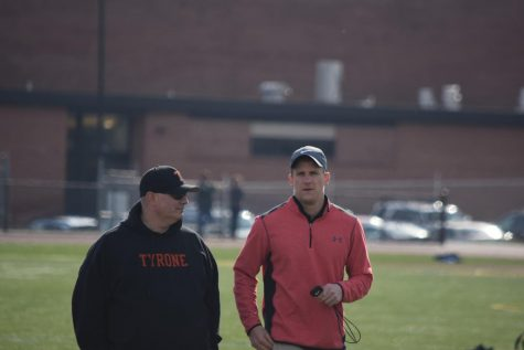 Jumping coach Dave Vasbinber and Head Coach Brad Kanuch at a meet last spring.