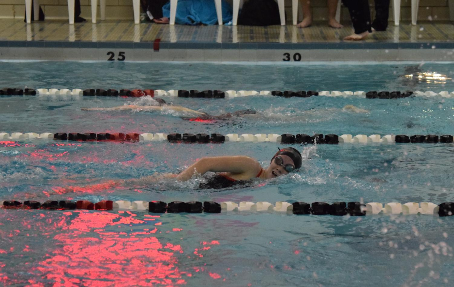 Madison Coleman swimming her final lap.
