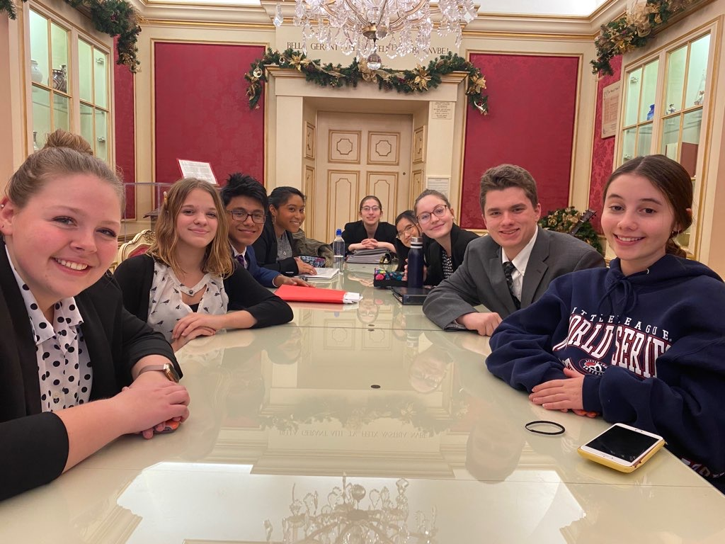 The Mock Trial A Team at the Cathedral of Learning in Pittsburgh. Left to Right: Lindsey Walk, Abby Kaspick, Mario Grugan, Ashlynn McKinney, Miranda Goodman, Sarah Butina, Emily Dale, Ben Delbaggio and Kat Lehner.