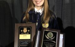 TAHS senior Kaylee Updike is shown with her State Star plaques and State Keystone Degree.