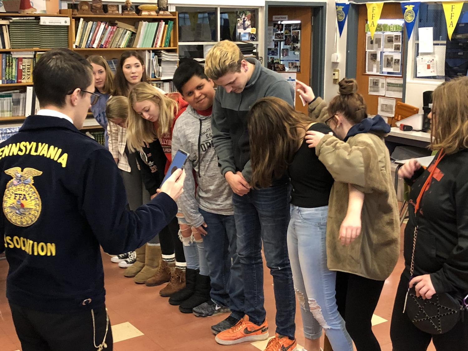 Pennsylvania State FFA Secretary Michael Riggs guides agriculture education students through a teamwork workshop.