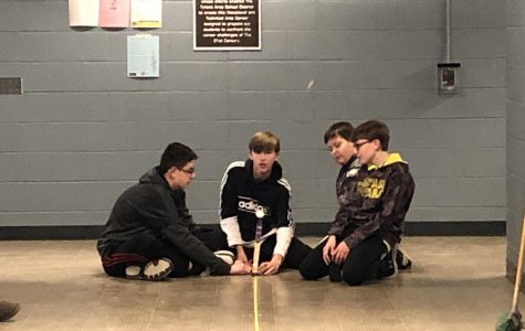 One of the groups sets up and gets ready to launch their catapult.