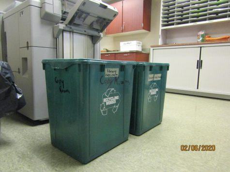 Shows the recycling bins in the copy room at JV