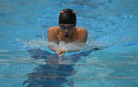 Junior Aden McCracken swimming the 200 IM