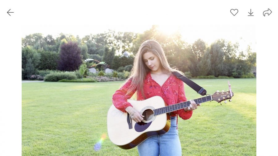 Madison is pictured with her guitar.
