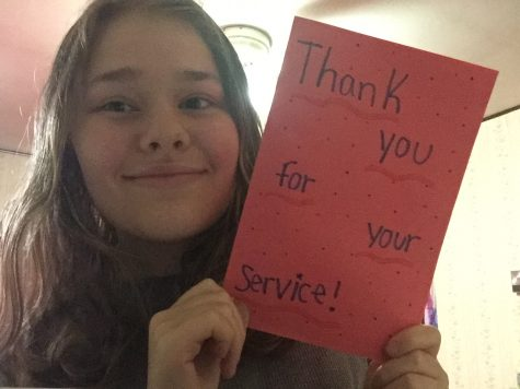 TAHS student Sarah Christofer with one of the handmade cards for veterans that will be sent to the VA Hospital in Altoona.
