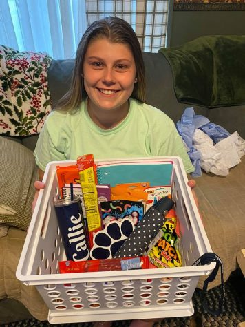 Callie Maceno with her basket of gifts