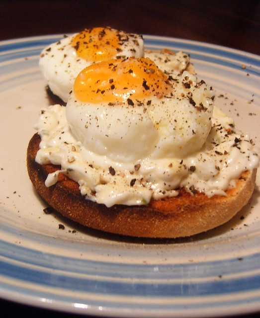 A+pair+of+lightly+seasoned+poached+eggs+placed+upon+warm%2C+freshly+toasted+english+muffins.