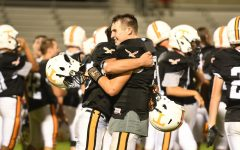 Dean Grassi hugs Brandon Lucas