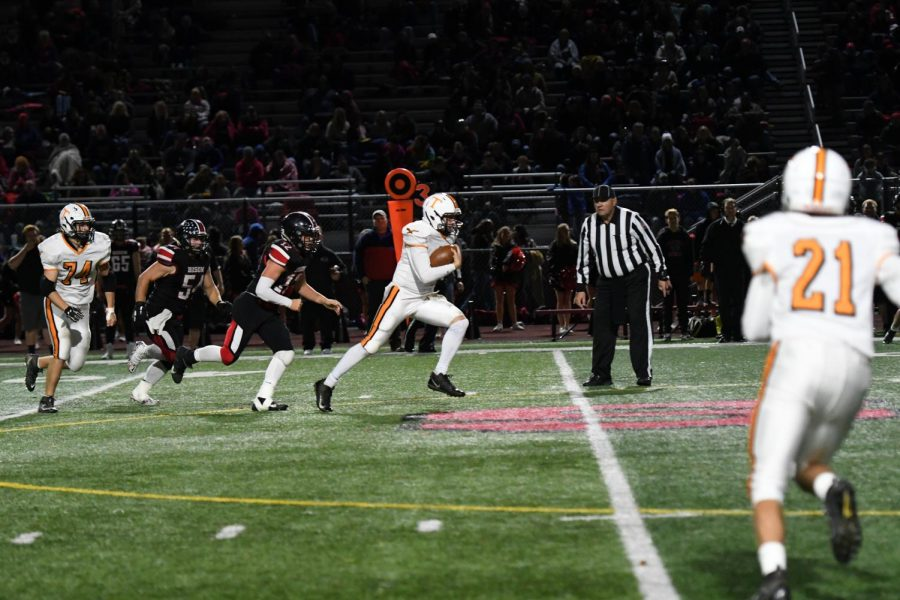 Brandon+Lucas+runs+the+ball+against+Clearfield+in+2019