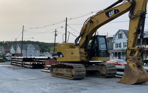 Machinery and new water pipes for the water system renewal sit in the Legion parking lot on 15th street.