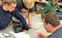 "Rayann Walls, Gavin Woomer, Justin Jackson, and Jesse Nevel were given clue to ""Break Into"" the Breakout Boxes by solving riddles and clues about FFA Career Development Events (CDE) and Leadership Development Events (LDE) during the 2019-2020 school year."