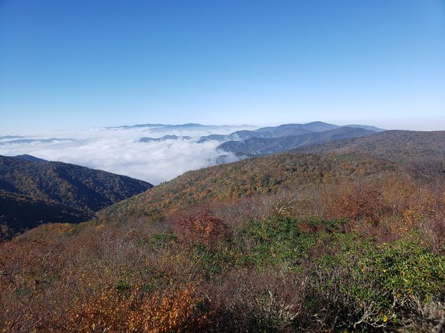 Clouds rolling of the Appalachian Mountains as the leaves change colours.