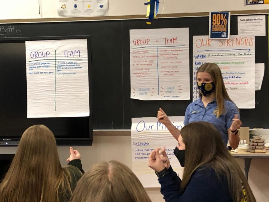 Mikara Anderson, State FFA President, lead the group in a round of snaps after summarizing the strong commitment and work the team completed during the COLT training on November 16, 2020.
