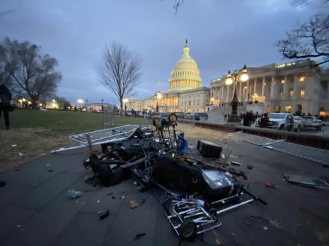 """A scene outside the US Capitol. A group of TV reporters were swarmed and chased away from their cameras, which a mob of President Trump's supporters trashed."" - Katie Mettler"