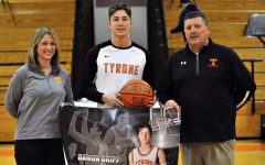 Sharon, Damon and George Gripp celebrate Damon's 1000th career point.