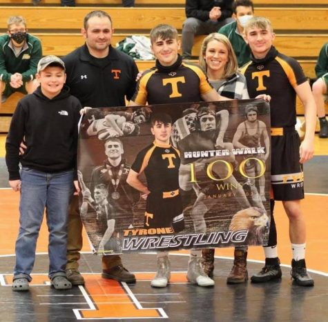 Tyrone senior Hunter Walk celebrates his 100th victory with his family.
