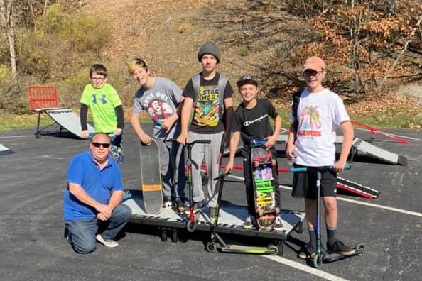 Mayor Latchford (bottom left) poses with some of the local skatepark.