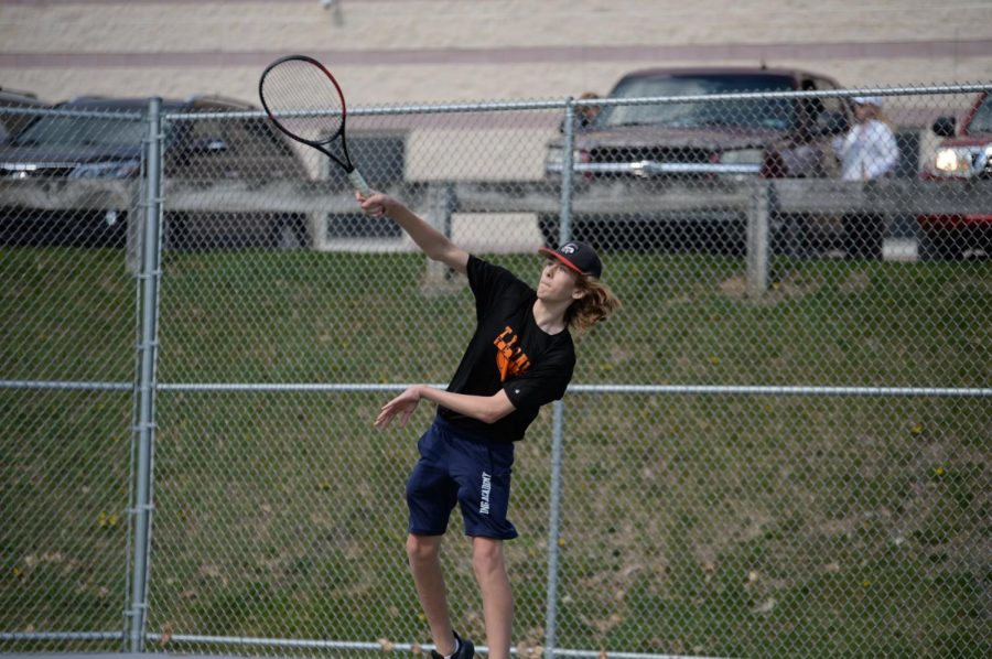 Will Grot smacks the ball across the net during a match
