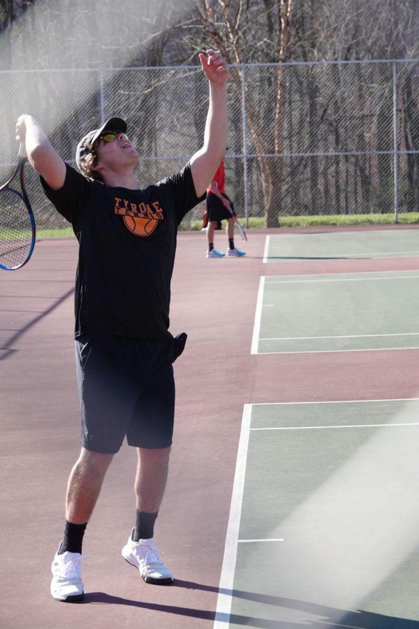 Andrew Savino begins a serve at a recent home match
